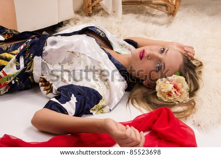 pretty girl lying on the floor in his room