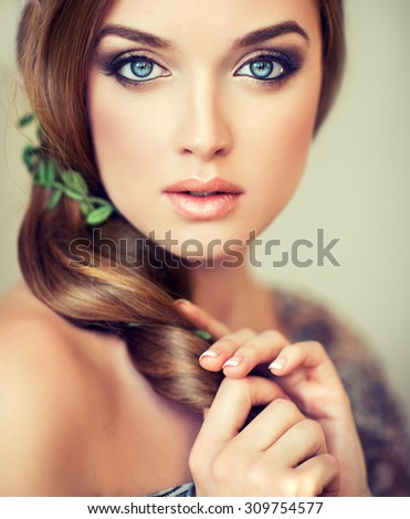 Pretty  girl with big beautiful blue eyes . Emotional expressive eyes , charming girl