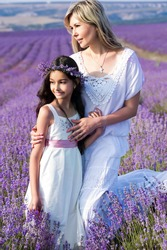 pretty girl with her mother in lavender field