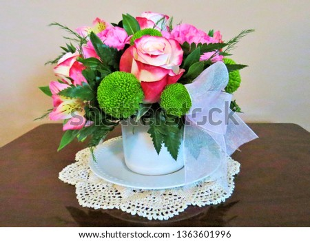 Pretty pink and green bouquet in a tea cup.                               #1363601996