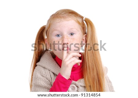 Pretty red haired little girl holding the secret