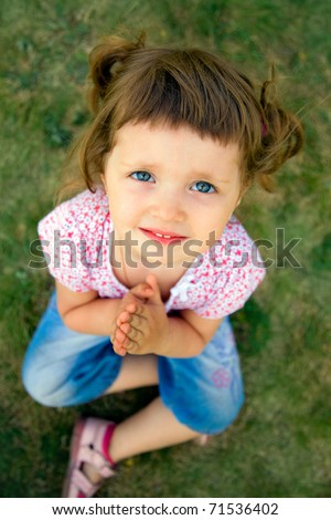 pretty young girl praying with her hands held together