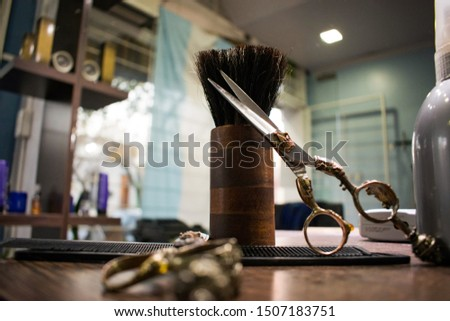 Professional hairdressing equipment on a hairdresser's table, the scissors have a very unique vintage style