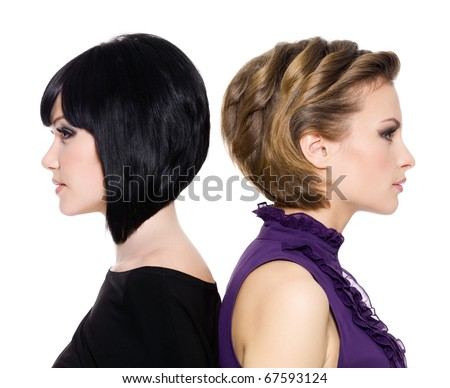stock photo : profile faces of two attractive adult girls standing back to ...