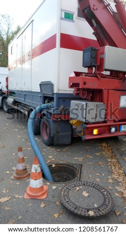 Pumping off the sewage tank of a mobile sanitary container into the sewage system  #1208561767