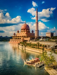 Putrajaya skyline. Boats on the foreground. Amazing view of  Putra mosque at sunset
