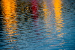 Quiet water with the reflection of colored lights which yields a colorful and colorful whole.