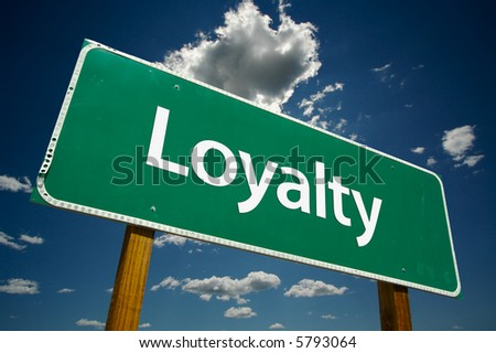 """""""Loyalty""""  Road Sign with dramatic clouds and sky. - stock photo"""