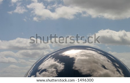 """""""pseudo planet"""" - metal sphere with cloud reflected in it - stock photo"""