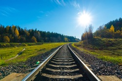 railway track in the autumn forest.Old  railway in the autumn evening