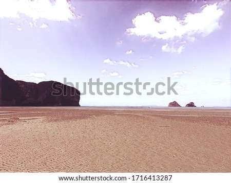 Rajamangala Beach, Beach in Trang Sea With mountains protruding into the sea When the water drops, you can see the brown sand beach and the beautiful white clouds in the sky.