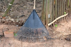 Rake, iron instrument used for clearing land in farms and farms, with a wooden handle, earthen floor in the background, wire fence and wood, Brazil, South America in photo zoom