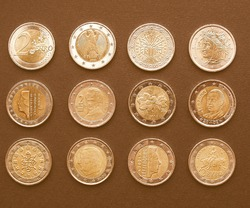 Range of European 2 Euro coins from many countries including Germany, France, Italy, Ireland, Spain, Portugal, Denmark vintage