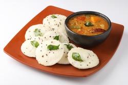 Rava Idly sambar or Idli with Sambhar and green, Popular South Indian breakfast