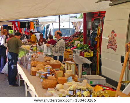 RAVENNA, ITALY MAY 21: cheese stand at the Wednesday outdoor market. The place is very popular in the city and attracts thousands of people. May 21, 2005 Ravenna Italy