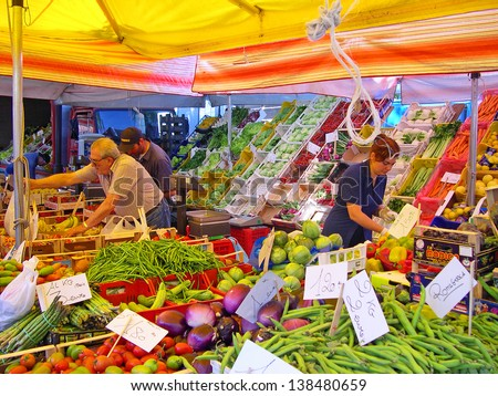 _ RAVENNA, ITALY MAY 21: vegetables vendor at the Wednesday outdoor market. The place is very popular in the city and attracts thousands of people. May 21, 2005 Ravenna Italy