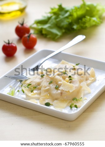 ravioli with olive oil and cheese sauce