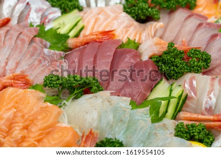 Raw fish Sashimi slice traditional Japanese food set includes Raw Salmon, Raw Tuna, Raw Yellow Tail (Hamachi),Raw flounder(Hirame),Raw  shrimp.