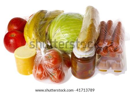 raw food isolated on white - apples, bananas, cheese, tomatoes,  cabbage, bread, sausages, eggs, pot with peppers, all wrapped for purchase - stock photo