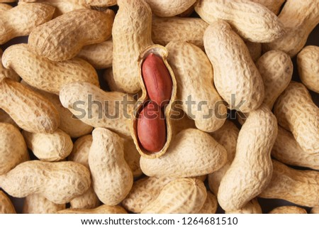 raw peanuts in the shell, background