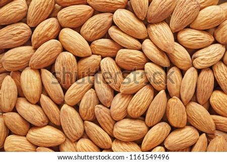 Raw peeled almond seeds background,almond nut is unsaturated fat food benefit for decrease blood cholesterol and good nutrition for diet and lost weight. #1161549496