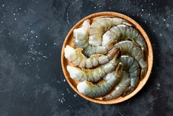 Raw shrimps in a plate top view