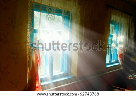 rays of sun pushing through a windows