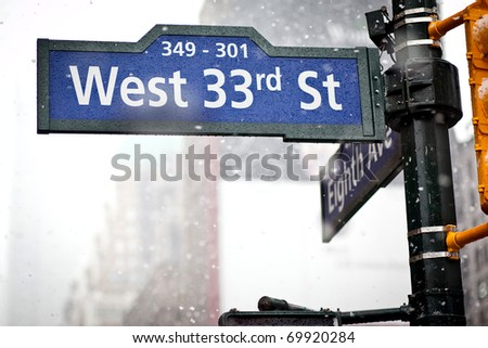 33rd street direction sign in New York in blizzard
