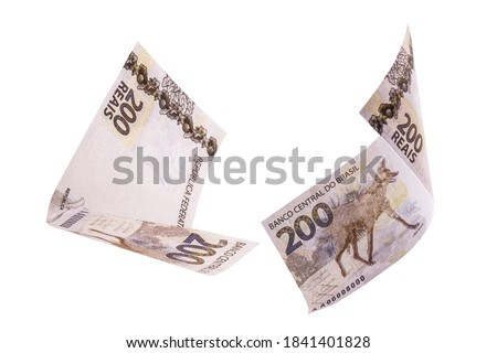 200 reais banknotes, bank notes falling on isolated white background. Two hundred reais from brazil, selective focus. Fall, inflation and loss concept Foto stock ©