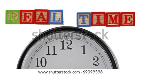 """Real-time"" in ABC baby blocks with clock isolated on white background."