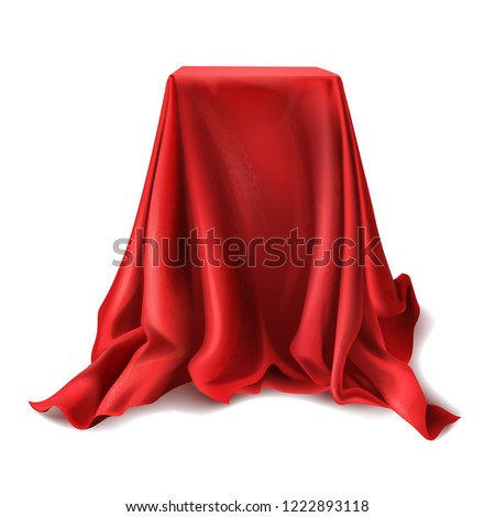 realistic box covered with red silk cloth isolated on white background. Empty podium, stand with tablecloth to show magic tricks. Secret gift, hidden under satin fabric with drapery and folds