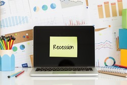 RECESSION sticky note pasted on the laptop screen
