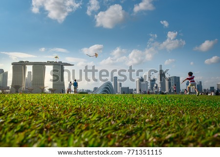 Recreation area in Marina Barrage, a dam in Singapore with singapore city view where people, including coup are social gathering