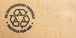 Recycle be environment friendly symbol on cardboard.