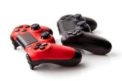 red and black joysticks for game consoles on a white background