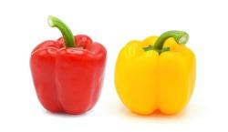 ฺRed and yellow bell peppers isolated on white background.
