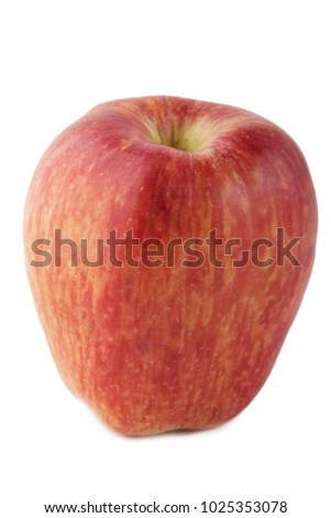 red apple elongated form isolate #1025353078