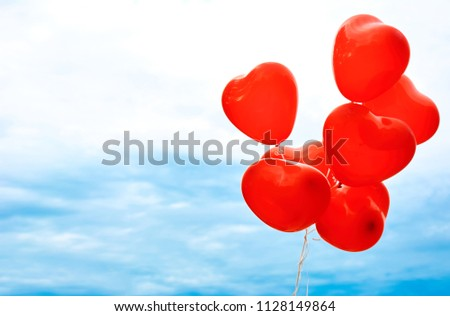 Red balloons against the background of the summer sky. Balloons in the form of a heart for lover.  #1128149864
