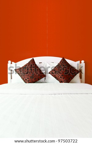 Red bedroom in a modern house - home interiors.