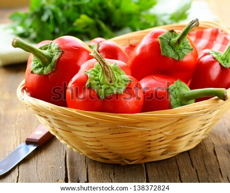 red bell paprika peppers in a wicker basket