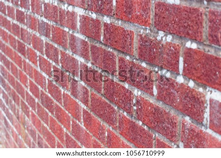 Red Brick Wall Close Up Side View 1056710999