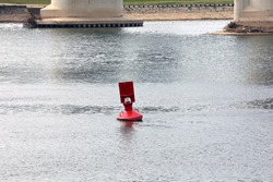 Red buoy in river water