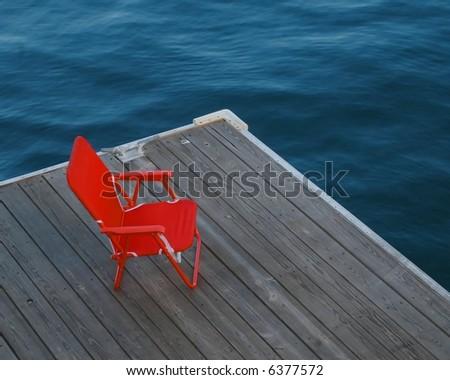 Red chair on dock, boston harbor massachusetts