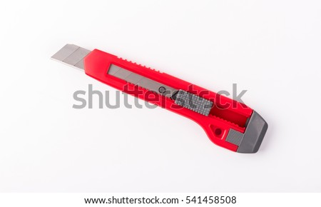 Red cutter knife isolated on white background.