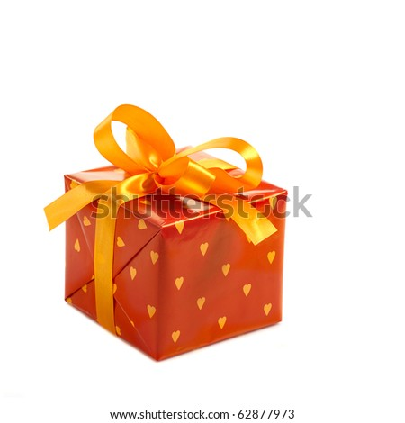 red gift box  decorated with yellow satin bow isolated on white