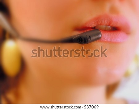 Red lips focused of a girl with headset phone at a call center.