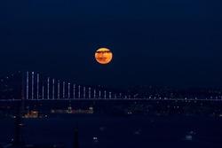 red moon. red moon on the Bosphorus bridge in Istanbul. Bosphorus view. dark weather. selective focus