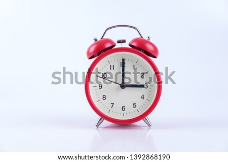 red old fashion analogue alarm clock  on  white background .It's 3 o'clock. Сток-фото ©