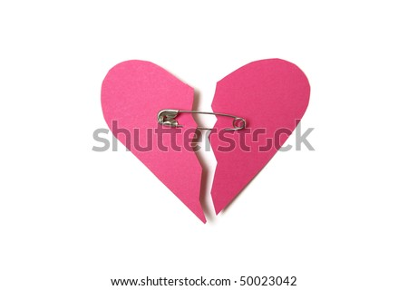 Red paper heart torn in half secured with safety pin on white background
