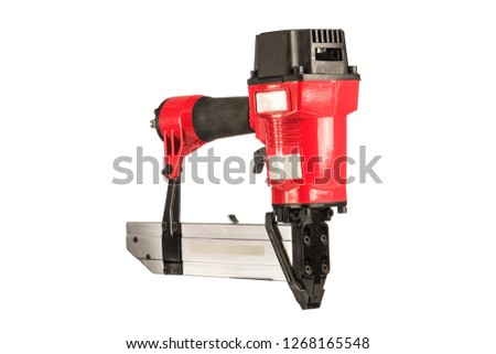 .Red pneumatic stapler on a white background. Isolated.